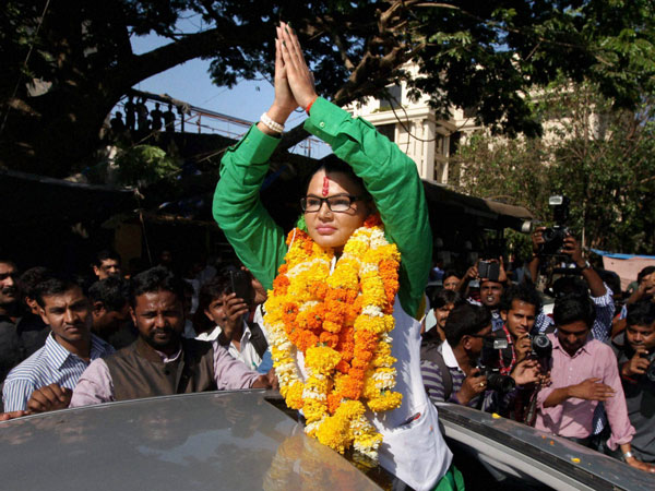 Rashtriya Aam Party leader Rakhi Sawant greets her supporters
