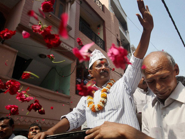 Arvind Kejriwal waves during an election campaign