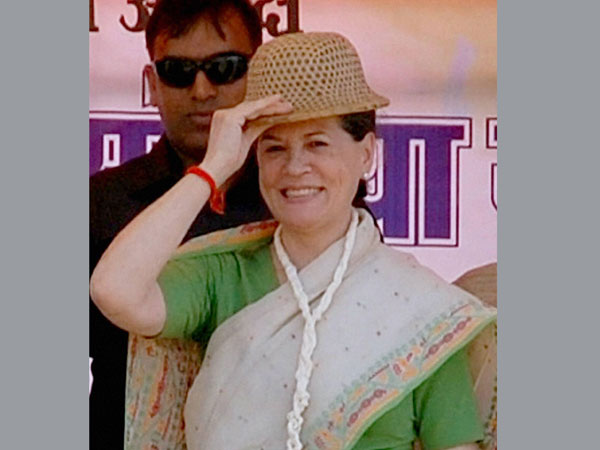 Sonia Gandhi wears a cap at an election rally in Sidhi