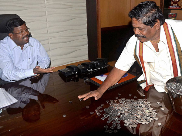 Kuppul G Devadoss deposits the fees in coins