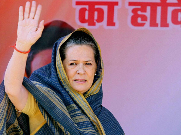Sonia Gandhi waves to supporters during an election campaign
