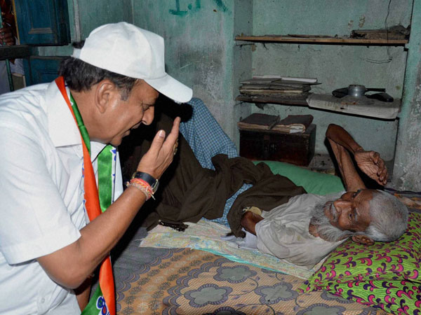 Dinesh Trivedi from Barrackpore interacts with an old voter
