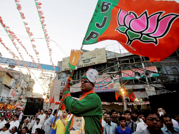A BJP's supporter during an election campaign rally