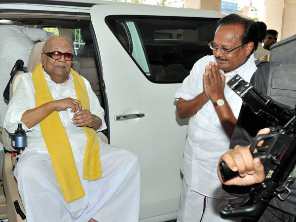 M Karunanidhi arrives at an election campaign ally in Coimbatore