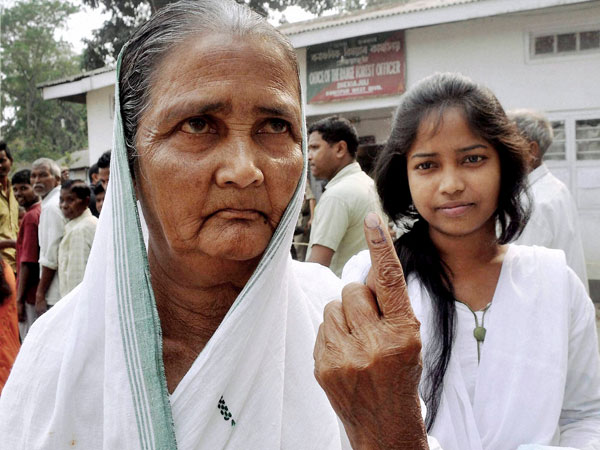 83 years old women shows the mark after casting vote