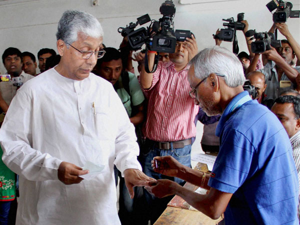 Manik Sarkar gets his finger marked as he arrives to cast his vote