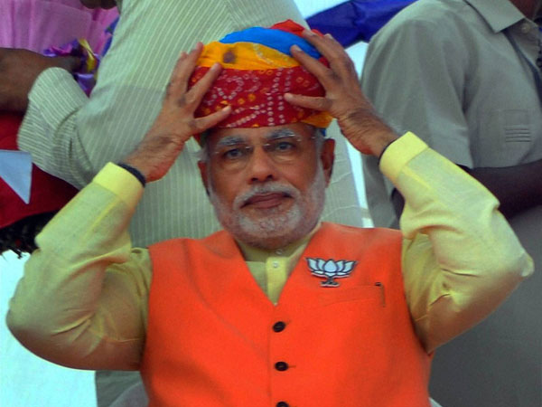 Narendra Modi wears a turban at an election rally