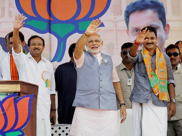 Narendra Modi waves after addressing the public meeting in Kasaragod