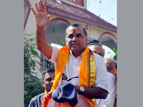 Paresh Raval waves during his election campaign