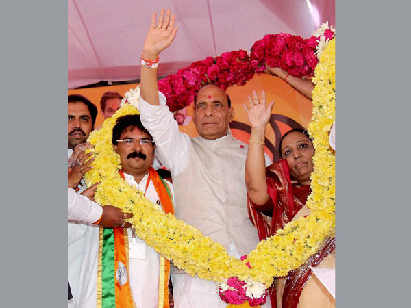 Rajnath Singh being garlanded at a public meeting in Latur