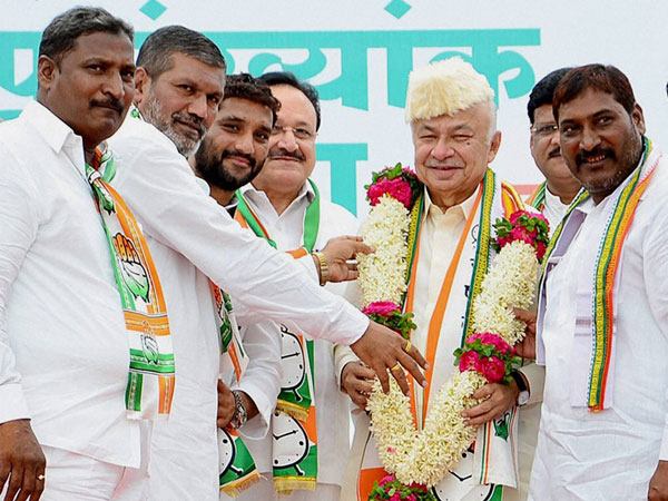 Sushil Kumar Shinde being garlanded at his election campaign