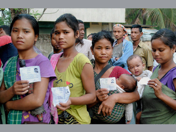 People show their voter identity card