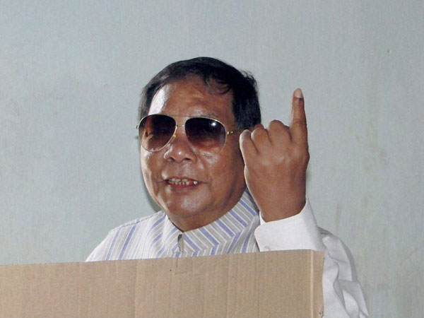 PA Sangma shows his ink-marked finger while casting his vote