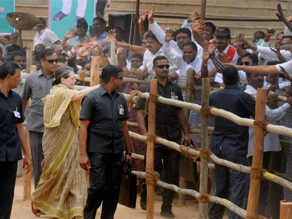 Sonia Gandhi meeting people during an election rally in Kolar