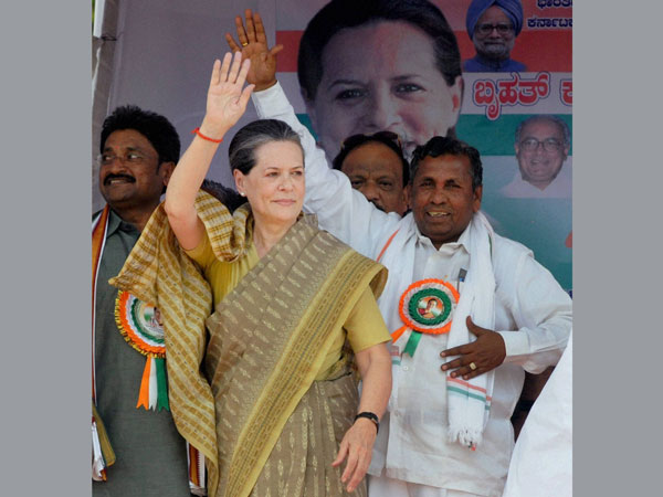 Sonia Gandhi waves to people during an election rally