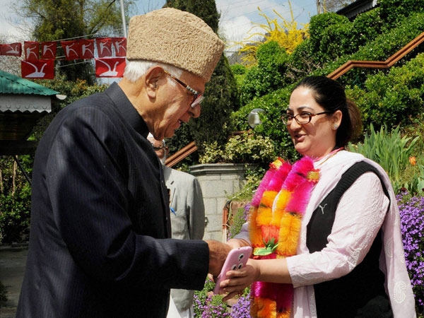 Farooq Abdullah greets a young woman to party in Srinagar