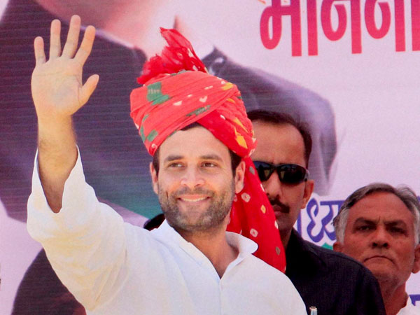 Rahul Gandhi waves during an election rally at Jhunjhunu