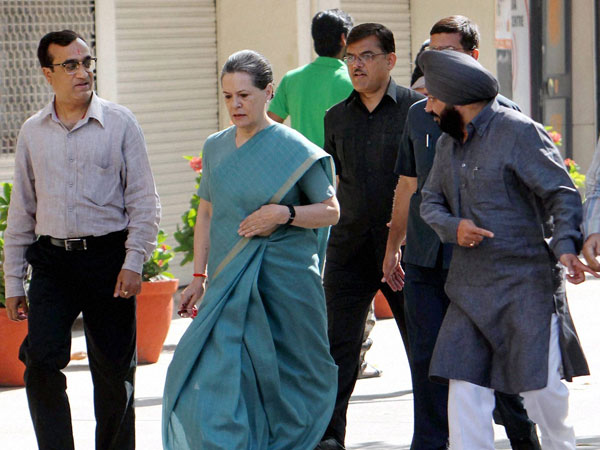 Sonia Gandhi with party candidate Ajay Maken arrives to cast her vote
