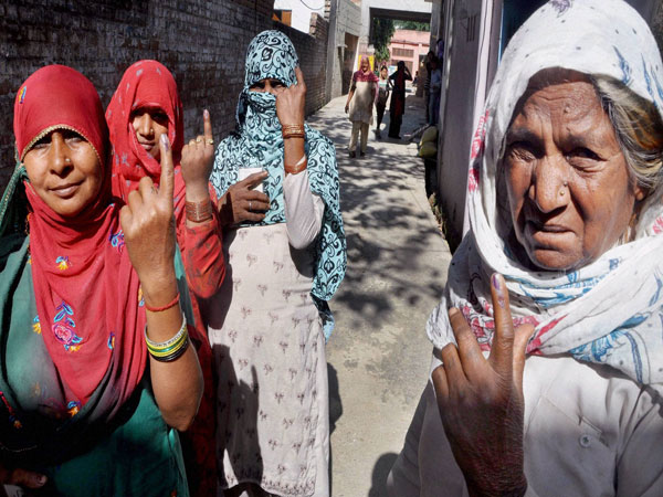 Women show their mark after casting their vote in Sonipat