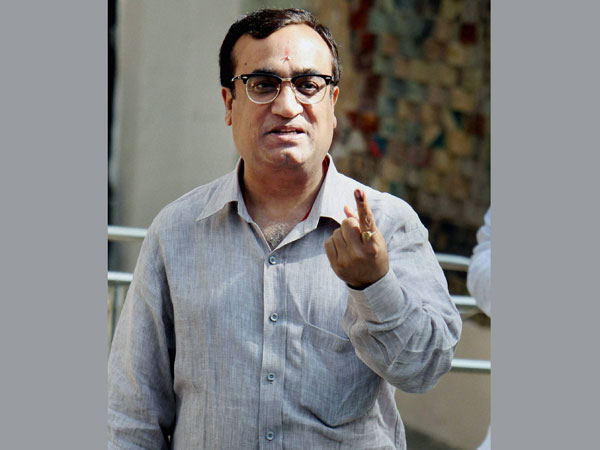 Ajay Maken shows his ink-marked finger after casting his vote