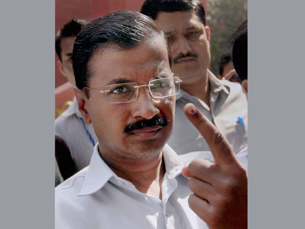 AAP convener Arvind Kejriwal shows the indelible ink on his finger