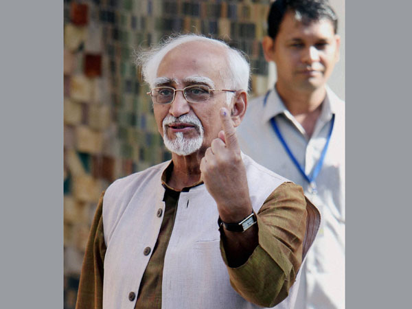 Hamid Ansari shows his ink-marked finger after casting his vote