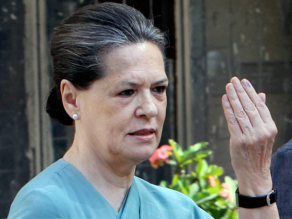 Sonia Gandhi shows her ink-marked finger