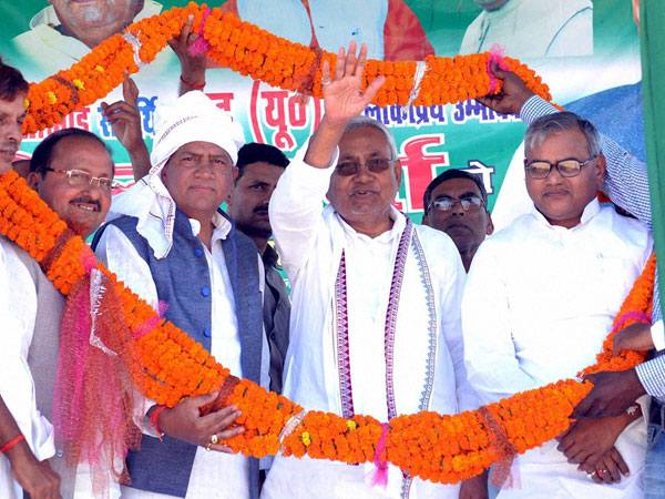 Nitish Kumar being garlanded during an election campaign