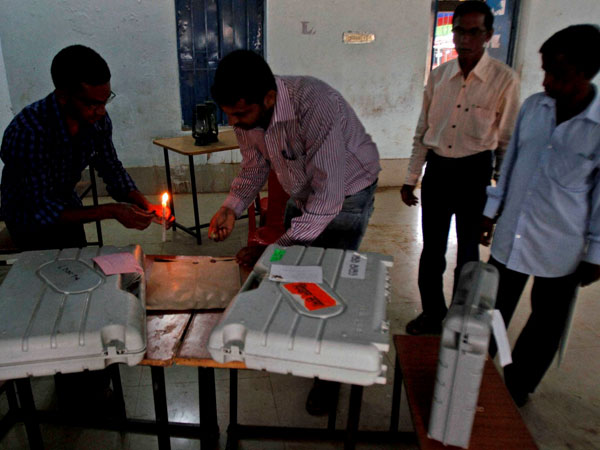 Election officers seal polling material