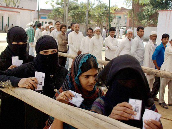 Muslim voters wait to cast their votes