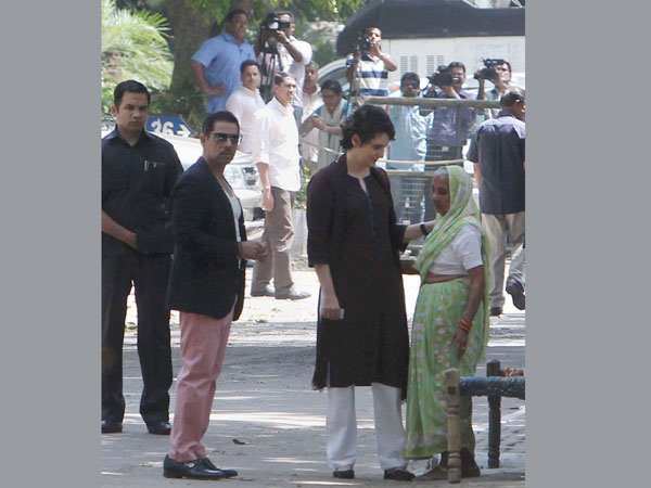 Priyanka Vadra interacts with an elderly woman
