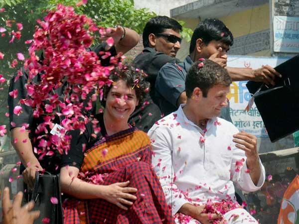 Supporters shower flower petals on Congress Vice President Rahul Gandhi
