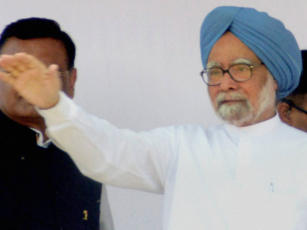 Manmohan Singh waves during an election rally at Puranpur