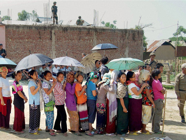 People wait to cast votes during re-polling for Lok Sabha