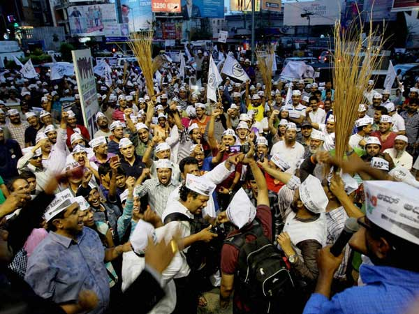 Aam Aadmi Party workers during a road show in Bengaluru