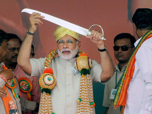 Narendra Modi being presented a sword at a public rally