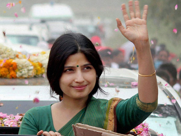 Dimple Yadav waves to the supporters during a road show