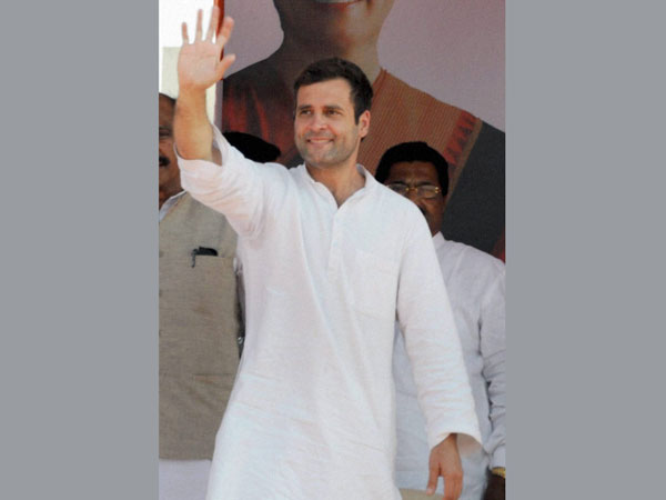 Rahul Gandhi waves to the supporters during an election rally