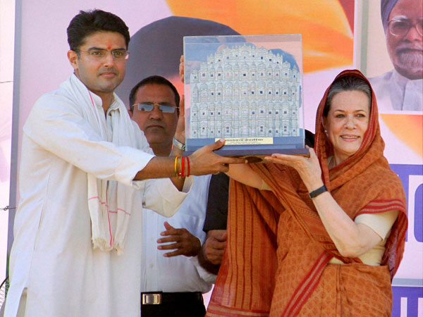 Sonia Gandhi being presented a memento