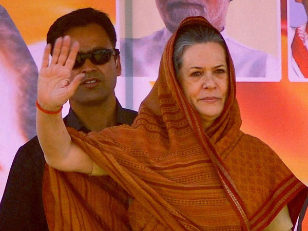 onia Gandhi waves to the supporters during an election rally