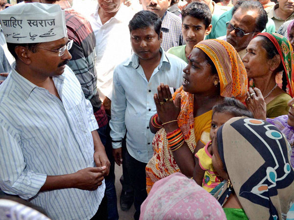 Arvind Kejriwal interacts with women during an election campaign