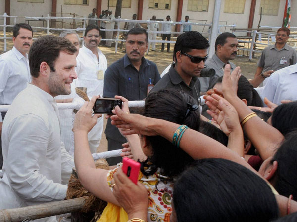 Rahul Gandhi crossing barricades while meeting supporters
