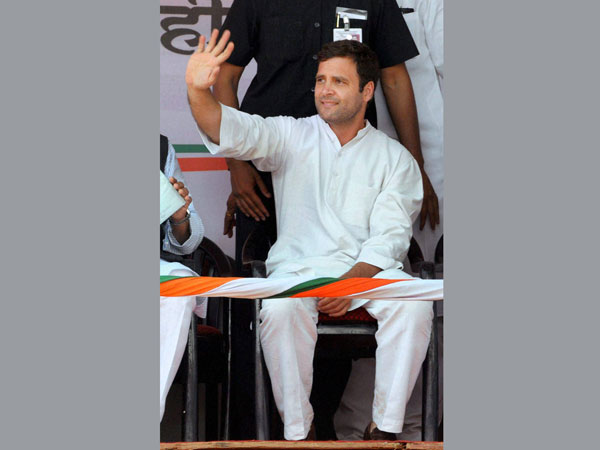 Rahul Gandhi waves at an election campaign rally in Pune