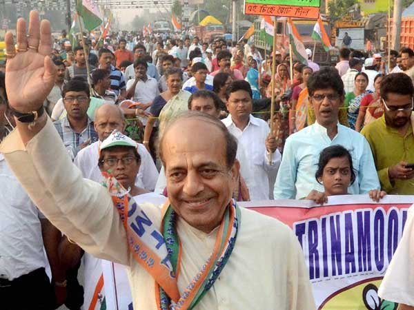 Dinesh Trivedi waves during his election campaign