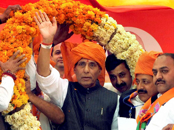 Rajnath Singh is garlanded during an election campaign