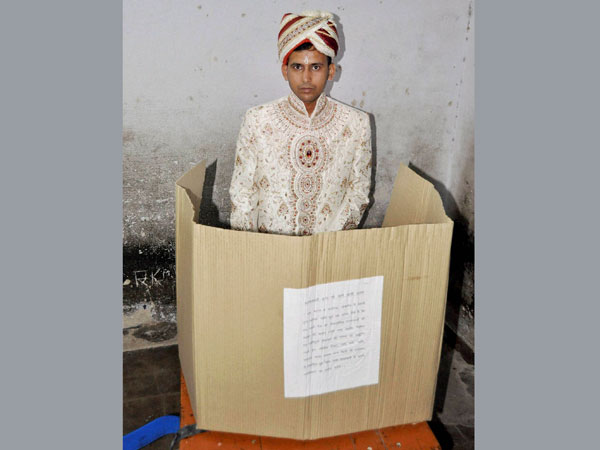 A groom casts his vote during the fifth phase