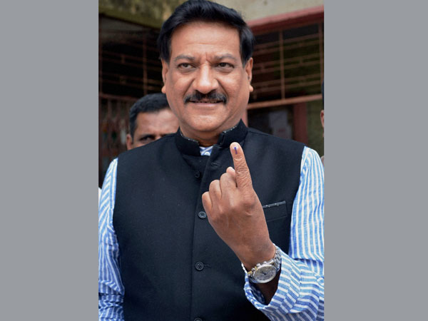 Prithviraj Chavan shows his inked finger after casting his vote