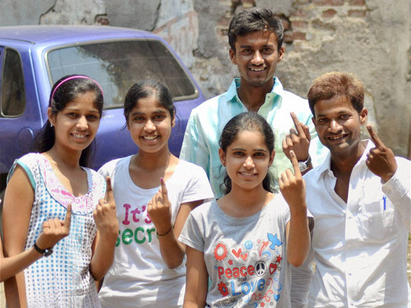First-time voters show their inked fingers