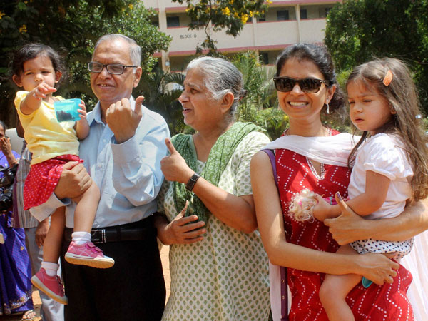 N R Narayana Murthy with his family after casting votes