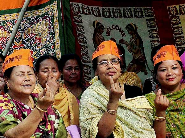 BJP supporters show thir ink-mark fingers at Imphal